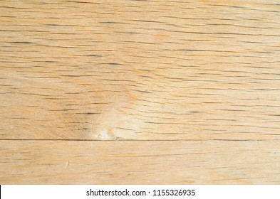 Texture of old weathered plywood, cracked from time and weather. Old furniture background