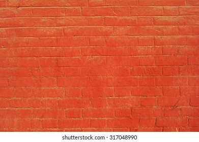 Texture of old weathered red brick wall