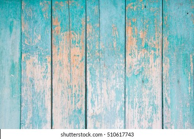 texture of old wooden boards covered in blue paint