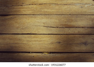 Texture of old wooden boards with sun spots. Horizontal format. Background for design. Copyspace