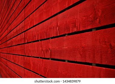 Texture of old wooden fence painted in red, Red painted cracked wooden boarding texture
