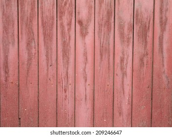 Texture of old wooden fence painted pink paint