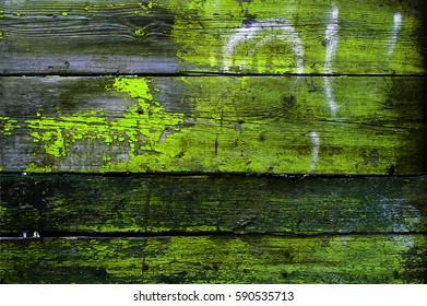 Texture of old wooden fence painted in yellow color