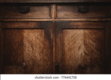 Texture of old wooden furniture. Vintage chest of drawers. Wood background, empty space, free space