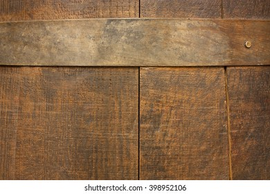 The texture of an old wooden (wine or beer) barrel with a stave