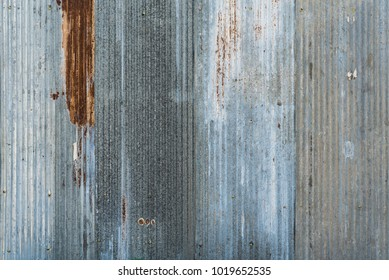 Texture of old zinc surface galvanized rust from the fence next to the house for background, old rusty zinc grunge texture, old zinc surface background The rust on the surface of zinc