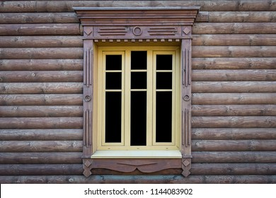 Texture of one wooden open window in a log house, isolated on a black background, copy space