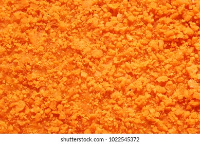 Texture of orange crispy chicken nugget. Macro shot