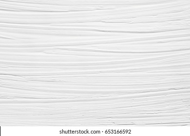 The texture of the paint is white. Drawing in a strip on the wall. Background for a wedding card.