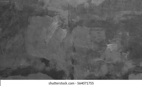 Texture painted in black color plaster on the wall.