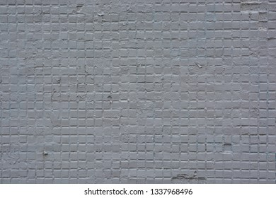 Texture of a painted brick wall. Background from the surface of a brick building.