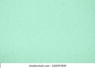 Texture of paper, light green mint color. Recyclable material, has small inclusions of cellulose. Fashionable modern background