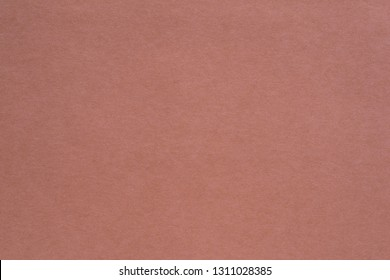 texture of paper or other material closeup for a background or for wallpaper of pale jester red color