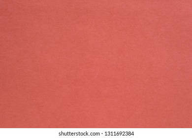 texture of paper or other material closeup for a background or for wallpaper of living coral color
