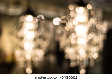 Texture, pattern, background. light crystal chandelier with blurred focus