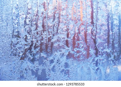 Texture, pattern. Frozen water on the glass, frozenned glass, Ice on window,winter icy patterns