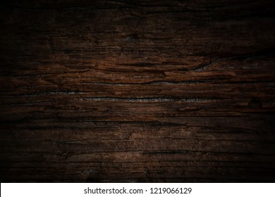 Texture and pattern of old dark brown wood.