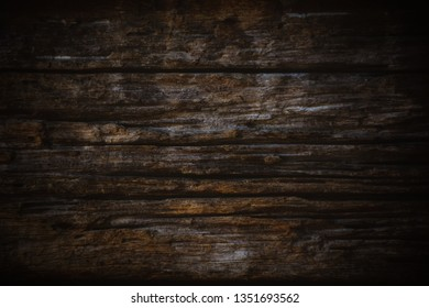 Texture and pattern of old dark brown wood.Old wood concept in vintage tone