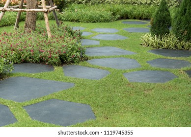 Texture or pattern of paving walkway background and group of duck statue decorated in the garden.