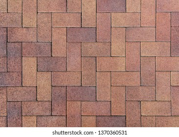 The texture of the paved tile on the bottom of the street. Cement brick squared stone floor background. Concrete paving slabs. Paving slabs