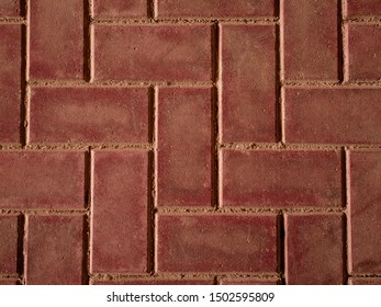 The texture of the paving slabs at the bottom of the street. Paving tiles, cement brick floor background. The texture of the paved tile. Cement brick stone floor background.