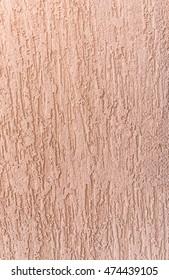 A texture of peach decorative plaster.