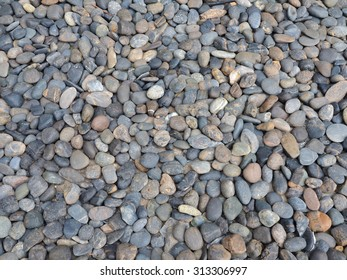 Texture of pebbles from a beach shore.