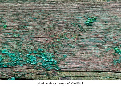 texture peeling green paint on a wooden board on the whole frame