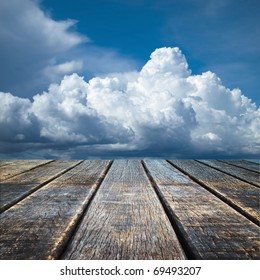 Texture of perspective Old wood floor and cloudy sky