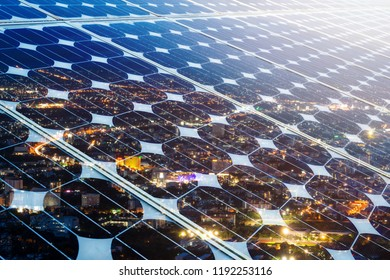 Texture of photovoltaic panels solar panel with city night light background, Alternative energy concept,Clean energy,Green energy.