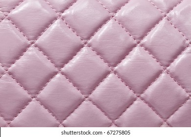 Texture of pink leather background closeup