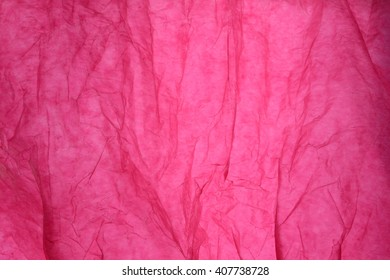 Texture of pink striped crumpled paper for pattern background