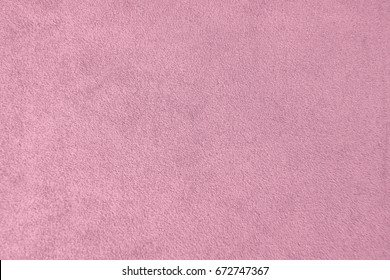 The texture of the pink velvet. The background of pink cloth. Background of pink velvet