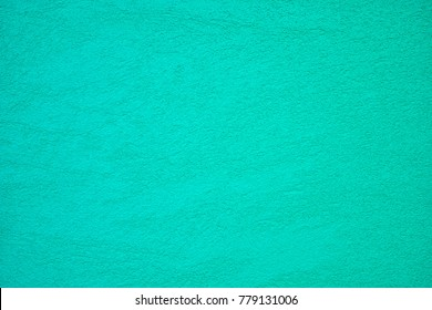 The texture of plastered tiffany blue or turcuoise wall, background
