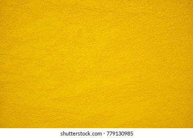The texture of plastered yellow or gold wall, background