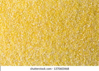 Texture of Polenta, yellow Cornmeal flour, Semolina, fast cooking closeup of grains