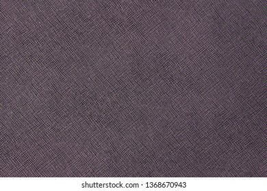 Texture of purple natural leather with lines and bumps. Backdrop or background.