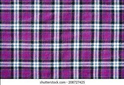 texture of purple scott pattern on fabric