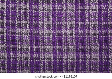 Texture of purple tartan fabric useful as a background