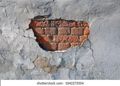 Texture of red brick masonry with cracked plaster