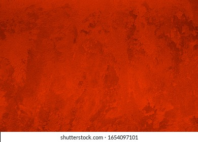 Texture of red decorative plaster or concrete. Abstract background for design. Art stylized banner with copy space for text.