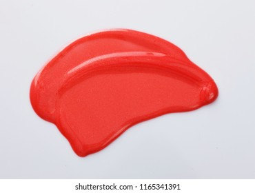 Texture of the Red Lipgloss liquid, white background