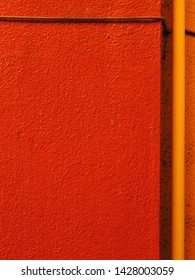 Texture of the red painted exterior wall