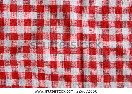 0061ce17703 Texture of a red and white checkered picnic blanket. Red linen crumpled  tablecloth.