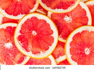 Texture of a ripe grapefruit slice, closeup