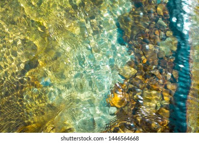 the texture of the river bottom through the water. river pebbles in the water. mountain river, place for text,