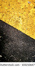 texture of roadblocks   used in parking and road for safety   yellow and black colored background of this roadblock