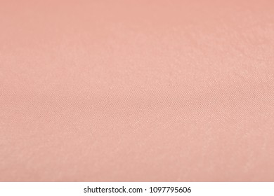 Texture of rose gold fabric as background