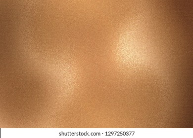 Texture of rough bronze metallic sheet, abstract background