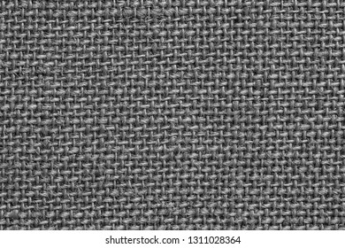 texture of rough fabric or textile material with a perepoleteniye closeup for a fashionable background or for wallpaper of gray color